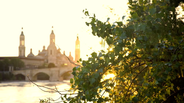 Sunset On the River In Zaragoza With Our Lady of the Pillar Basilica On The Background video