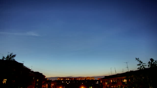 Sunset over a city, the star sky, Time Lapse video