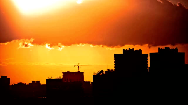 Sunset over downtown city skyline on silhouette of architecture video