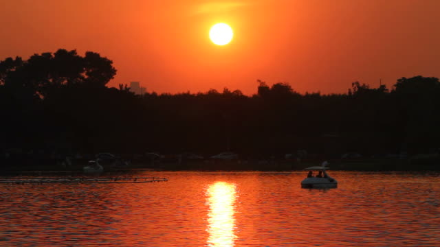 Sunset over lake in the sunshine day video
