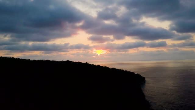 Sunset over peninsula silhouette video