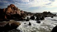 Sunset over rocky coast video