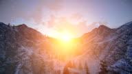 Sunset over snowy mountain ridge video