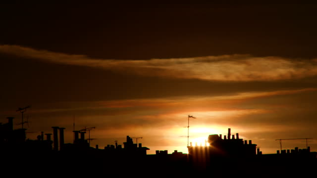 Sunset over the chimneys on Paris rooftops video