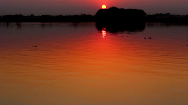 Sunset Over the Lake and Sun Reflecting in the Water video