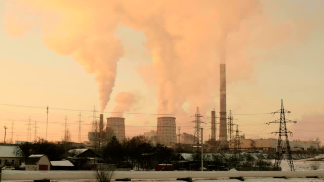 Sunset over the thermal power station. Real time wide shot. video