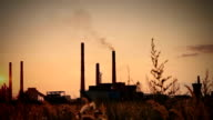 Sunset polluted sky with chemical plant background video