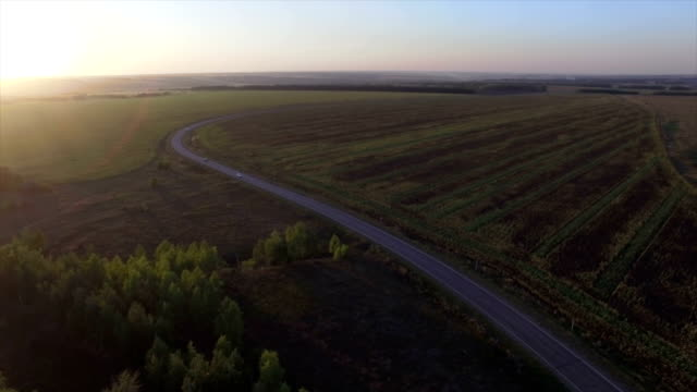 Sunset road, aerial view, early autumn. video