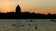 Sunset rowing on lake in front of government building 2 video