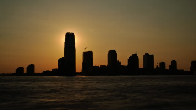 Sunset Silhouette over buildings and water video