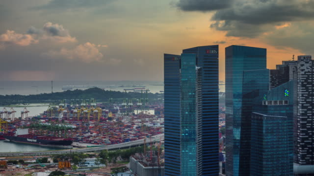 sunset singapore port and business block 4k time lapse from the roof top video