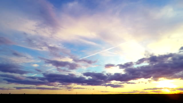Sunset Sky over the Green Field. video