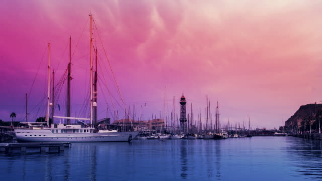 Sunset sky over yachts in marina. Timelapse of pink sky over yacht port video