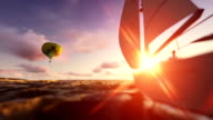 Sunset summer time, air balloon and yacht sailing video