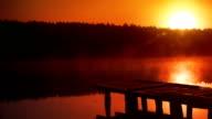 Sunset - sun reflecting in the lake. Romantic sight. Loop. video