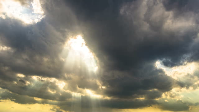 Sunset / sunrise with clouds, light rays and other atmospheric effect video