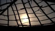 sunset through broken hut video