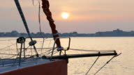 sunset through the rigging sport boat at the pier video