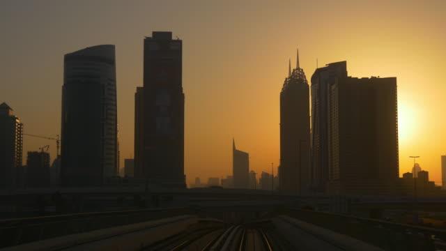 sunset time sun light dubai marina metro ride front panorama 4k united arab emirates video
