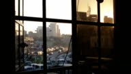 Sunset with traffic through a window in Nairobi, detail video