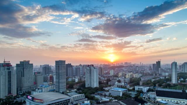 Sunset.Time lapse of the poly plaza in Wuhan.Aerial view of high rise video