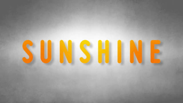 Sunshine headband. Text from sand. With black background video