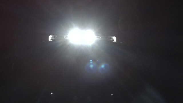 super bright lights on top of emergency vehicle at night video
