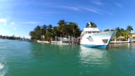 Super cruisers luxury motor yachts moored Miami waterfront, USA video