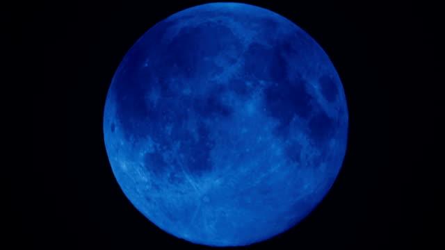 Super full moon moving down night sky HD Video video