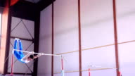 HD: Super Slo-Mo Gymnast Performing Routine on Horizontal Bar video