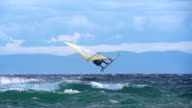 HD Super Slo-Mo: Man Jumping Wave on Windsurf Board video
