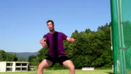 HD: Super Slo-Mo Shot of male discus thrower video