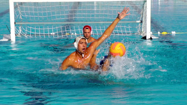 HD: Super Slo-Mo Shot of Water Polo Scoring Action video
