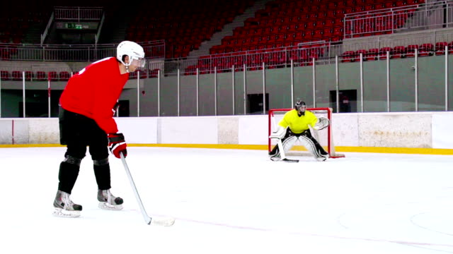 HD: Super Slo-Mo Shot of Young Player Shooting at Goal video