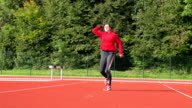 HD: Super Slo-Mo Shot of Young Woman Throwing Javelin video