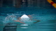 HD Super Slo-Mo: Teenager Performing Front Crawl During Swimming Competition video