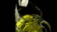 Super slow mo lemonade ice falls video