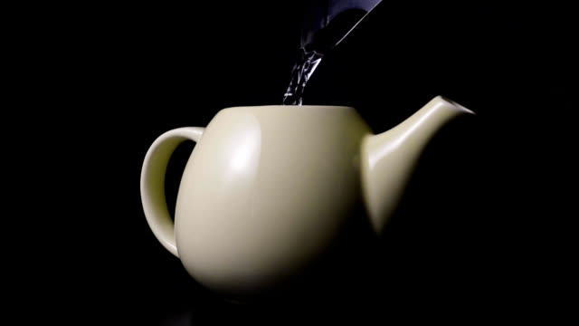 Super slow mo pouring boiling water into the teapot video