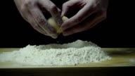 Super slow motion cook breaks egg video