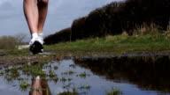 Super Slow Motion HD - Jogging with puddle splash video
