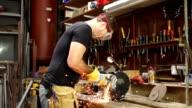 Super Slow Motion HD, Sparks fly Grinding metal in Workshop video