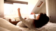 Super Slow Motion HD - Woman Falling backwards onto Bed video