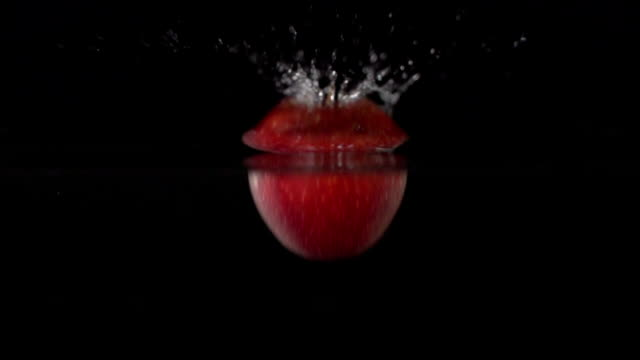 Super Slow Motion: Red Apple splashing video