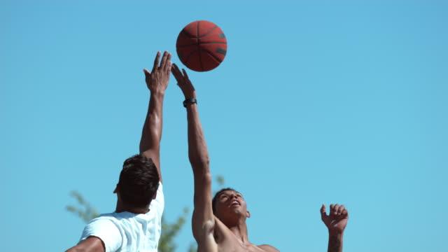 Super slow motion shot of basketball tip off video