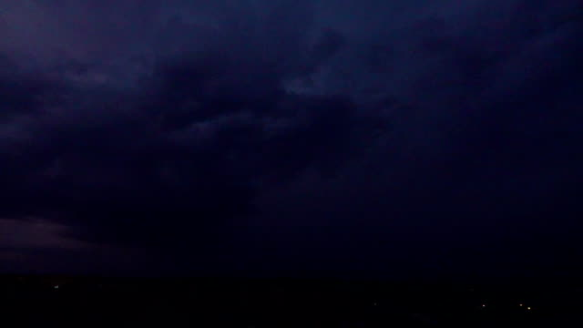 Super slow motion shot of several lightning strikes in the same place at night video