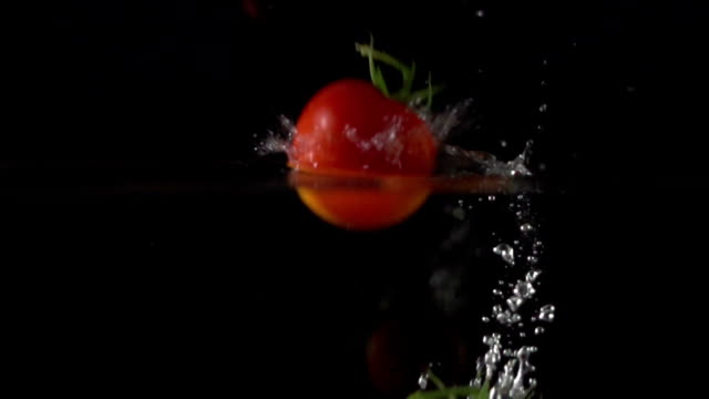 Super Slow Motion: Tomatoes splashing into water video