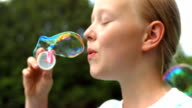 HD Super Slow-Mo: Adorable Girl Blowing Bubbles video