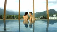 HD Super Slow-Mo: Affectionate Couple In The Pool video