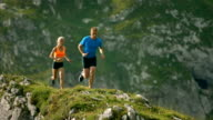 HD Super Slow-Mo: Athletes Running On A Mountain Trail video