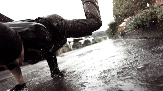 HD Super Slow-Mo: B-Boy Dancing In The Rain video